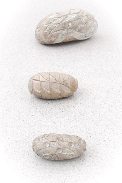three gray spa stones isolated on white background